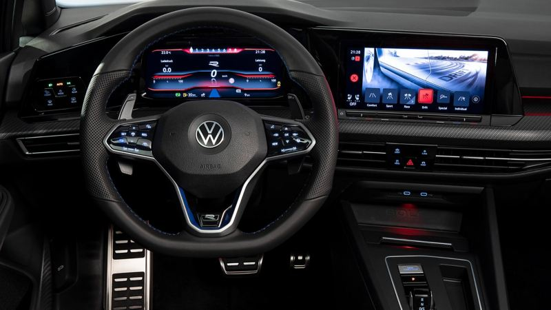 VW Golf R interior cockpit with focus on the steering wheel and Infotainment system