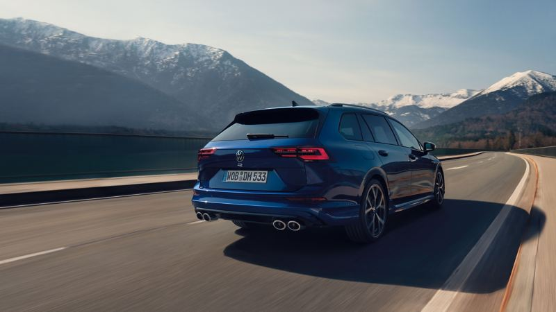 The VW Golf R Estate in Lapiz Blue driving along a mountain road