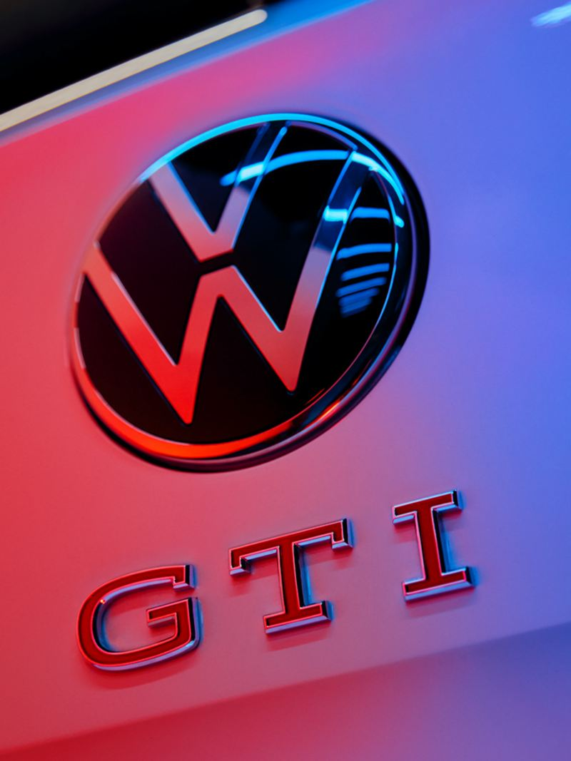 Close-up of the VW logo and the GTI badge with red letters on the rear of the Polo GTI.