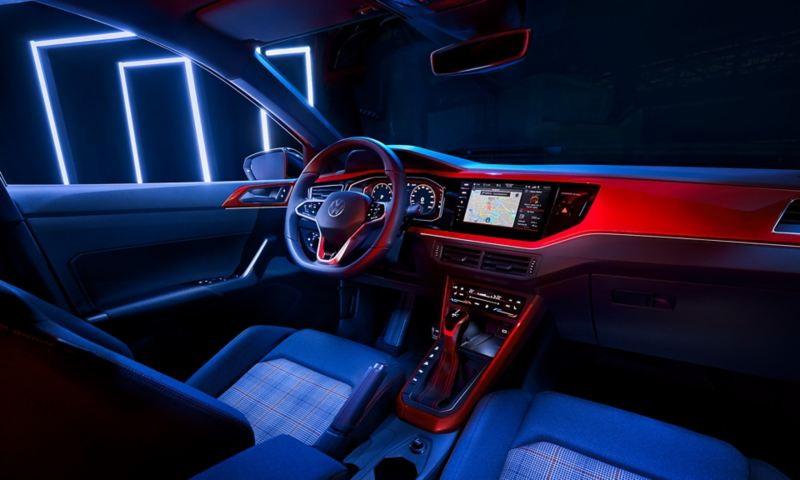 View from the back seat into the cockpit of the VW Polo GTI with the multifunction steering wheel, Digital Cockpit Pro and Standard Climatronic