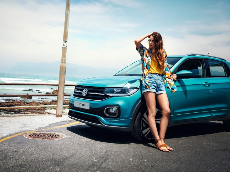 t-cross in blue with woman posing in fornt