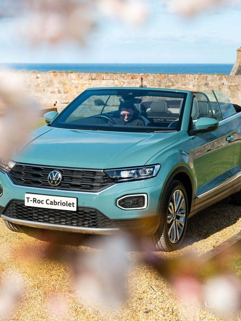 A blue T-Roc Cabriolet from 3/4 front angle