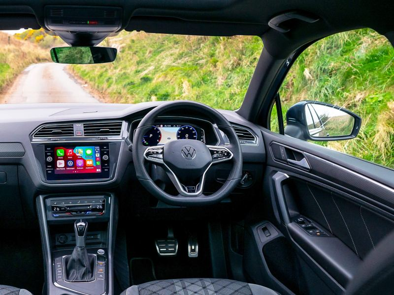 An interior shot of the VW Tiguan cockpit showing infotainment system
