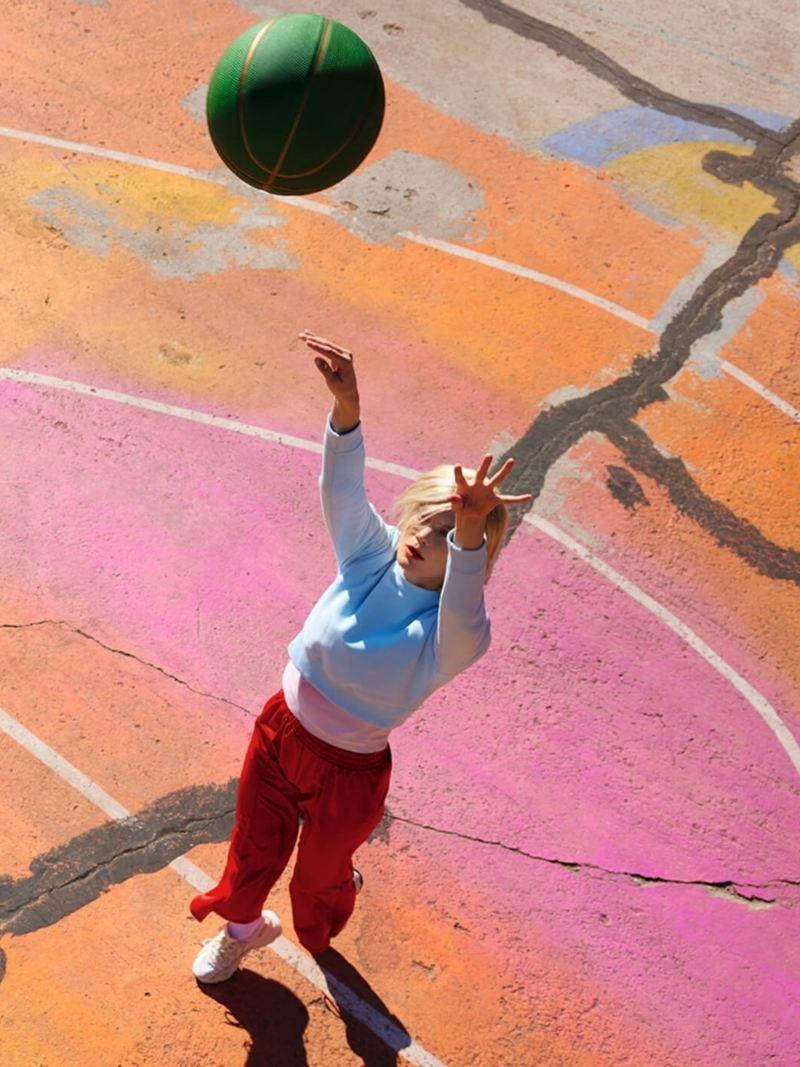 A woman playing basketball