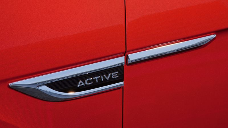 """Close up of an """"ACTIVE"""" badge on a red VW T-Roc Cabriolet."""
