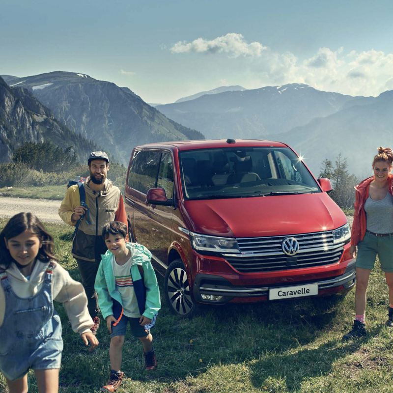 Family outdoors next to a parked Caravelle