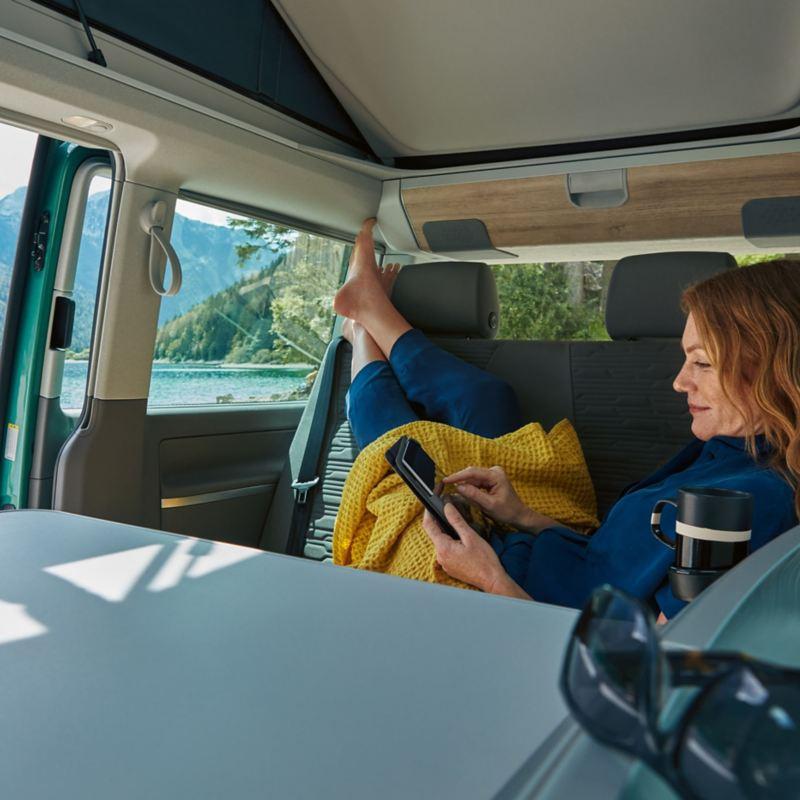 Woman inside California camper van