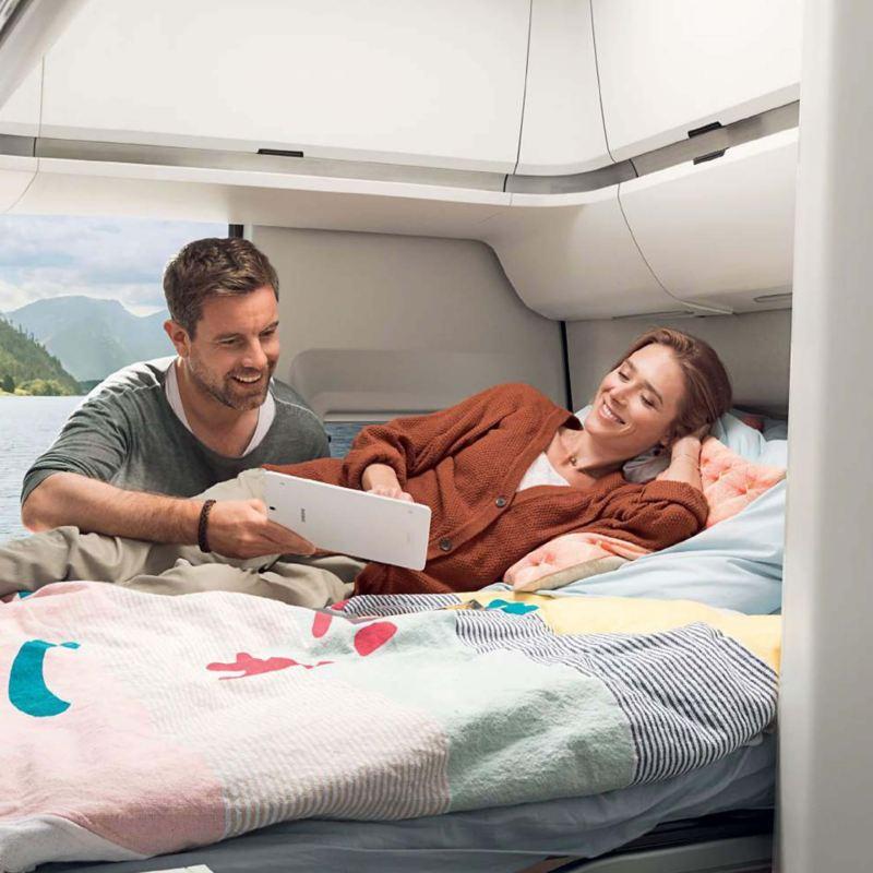 Couple sat inside a camper van