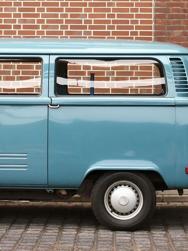 The Volkswagen T2 being charged at the charging station