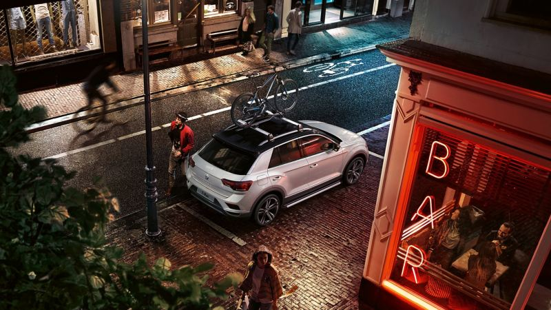 A bike on the roof of a Volkswagen car