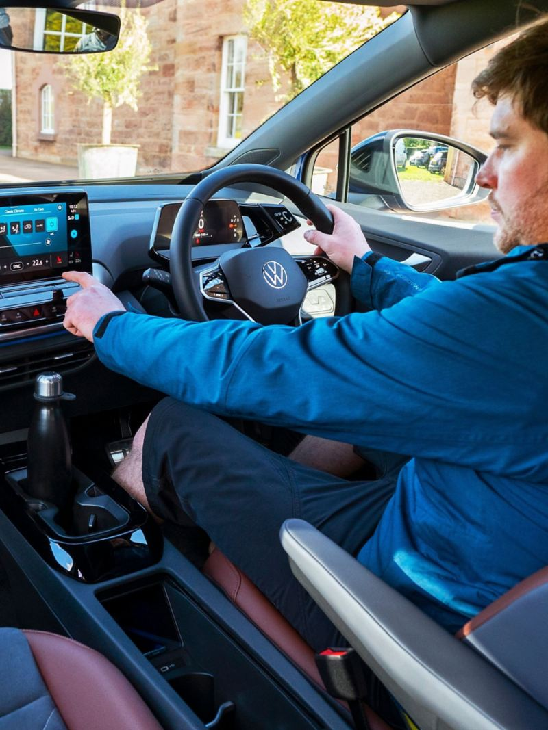 A customer inside a VW ID.4 picking music using the infotainment screen