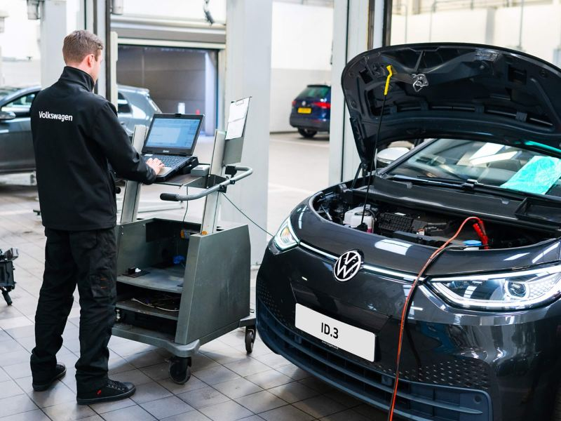 A technician performing a software update on a VW ID.3