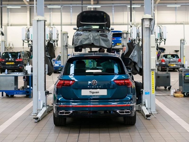 rear view of a blue VW Tiguan parked in a workshop