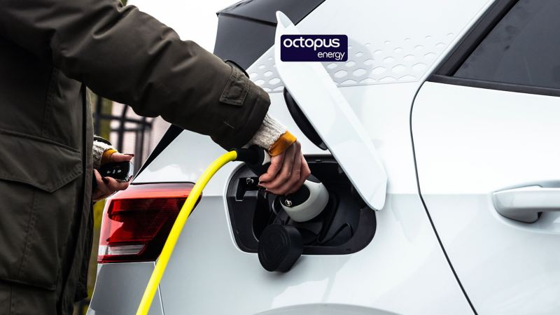 Woman charging her electric car with our partner Octopus Energy