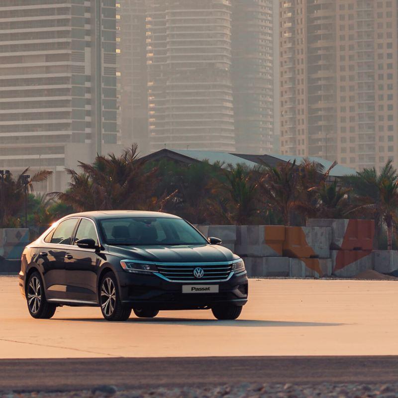 The 2020 Volkswagen Passat parked on a habor overlooking the city of Dubai