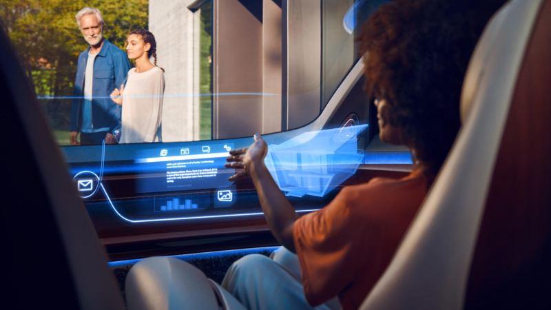 A woman sitting inside an ID. electric car