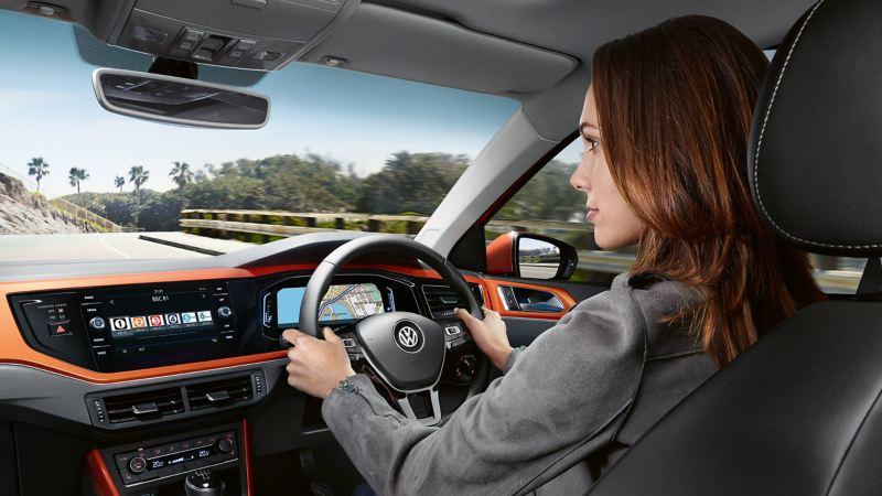 A woman driving a Polo Beats