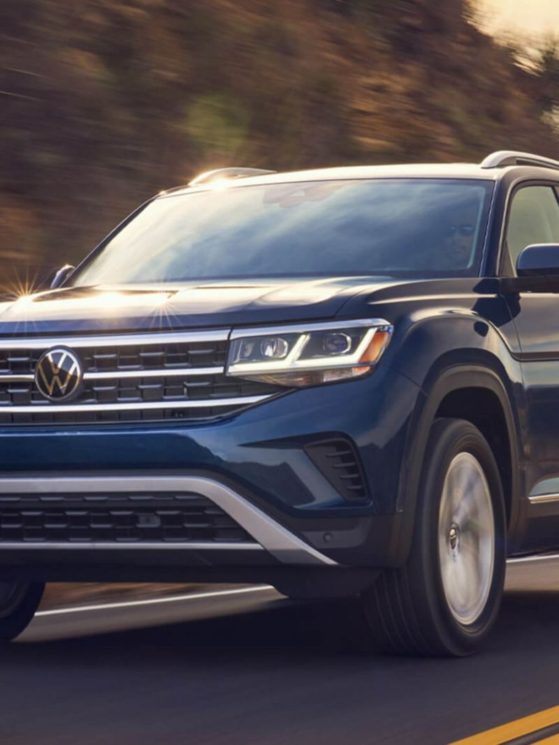 The Volkswagen Teramont driving around a mountain