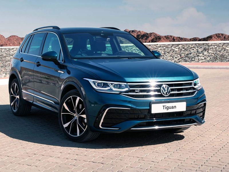 Volkswagen Tiguan parked with mountains in background