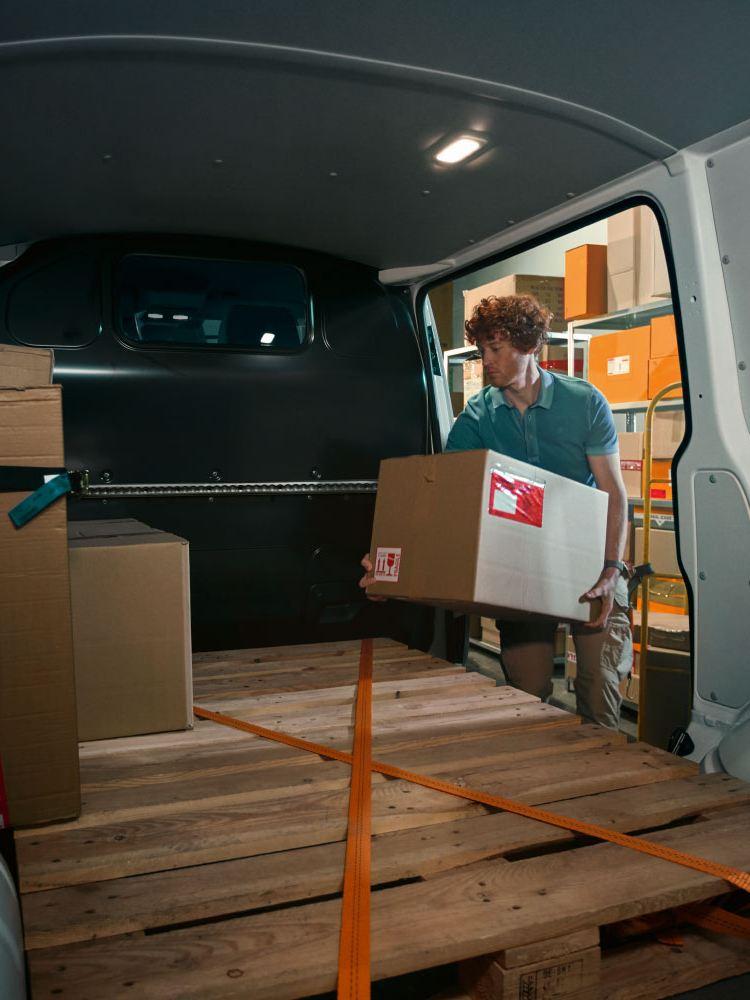 man loading cardo into transporter panel van 6.1