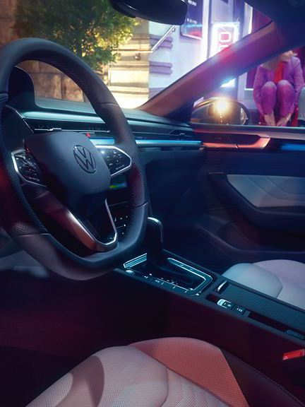 A drivers view of the Arteon Shooting Brake's interior, showing its leather steering wheel and stylish dashboard.