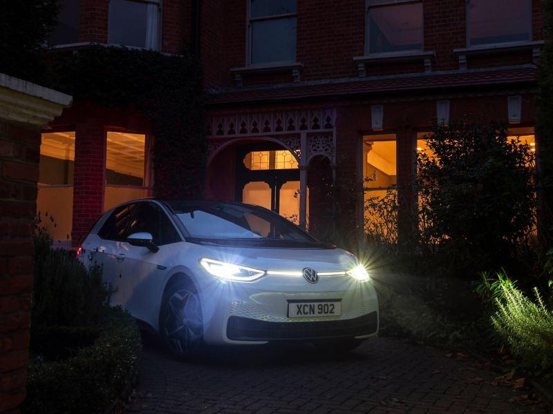 A white ID.3 parked outside a house, showcasing its Matrix LED headlights.