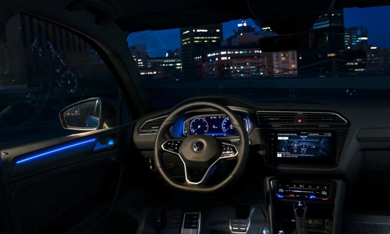 A view of the New Tiguan cockpit from the drivers seat, hilighting it's ambient lighting.