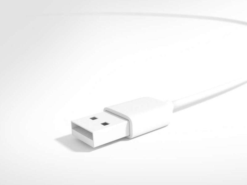 Un câble USB blanc