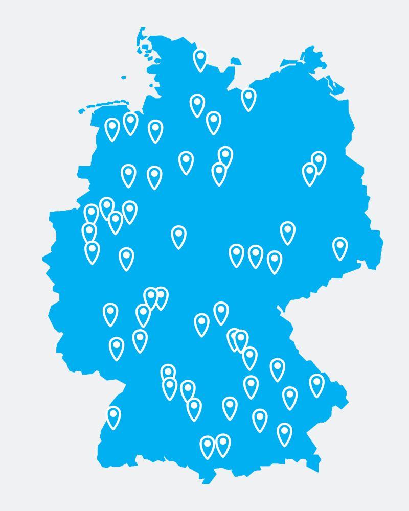 Eine blaue Deutschlandkarte mit GPS-Markern.