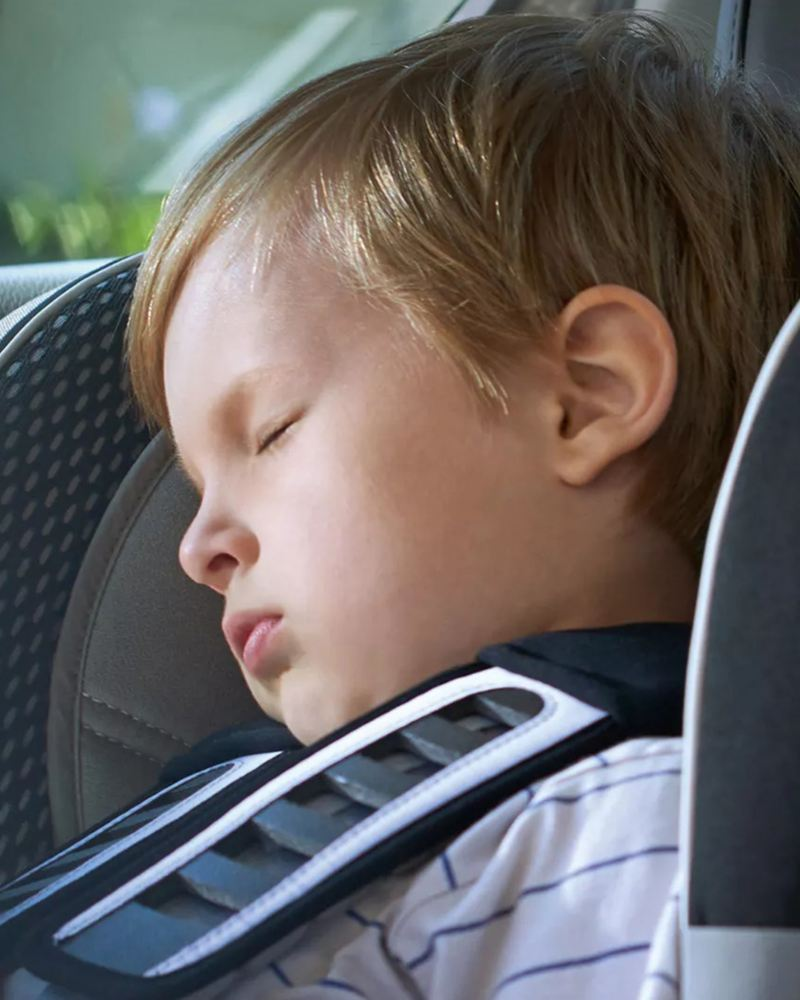 """A baby is sleeping in a VW car, link out to VW's """"volkswagen protection plus"""" page"""