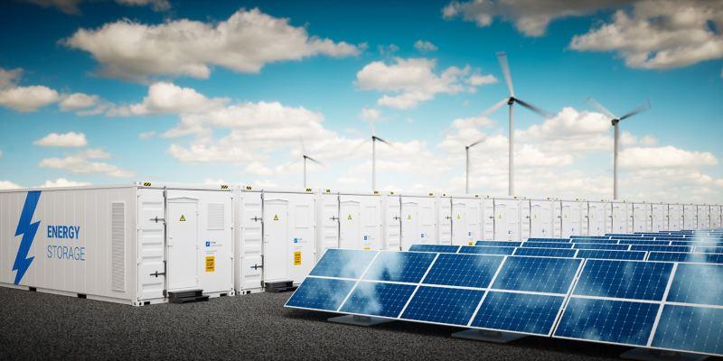 Solarzellen und Windräder schicken in dieser Grafik Strom in Energiespeicher