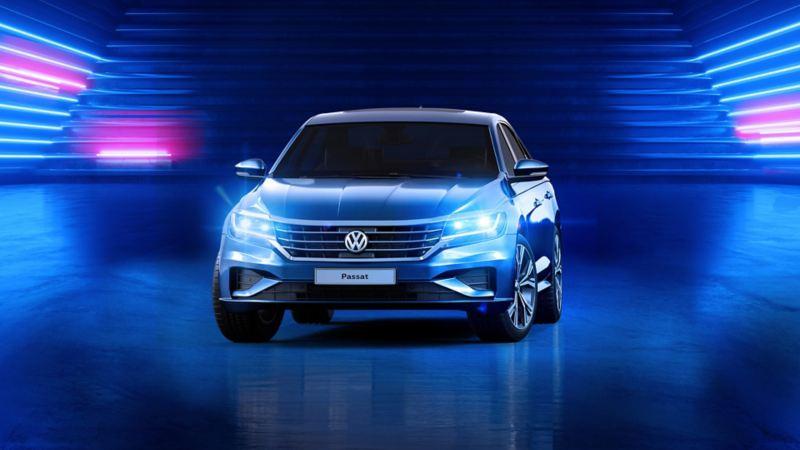 The VW Passat parked in a blue room - the Volkswagen Oman Passat offer