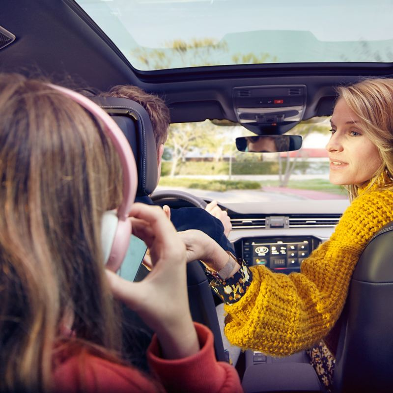 Family in car making the most of the data plans