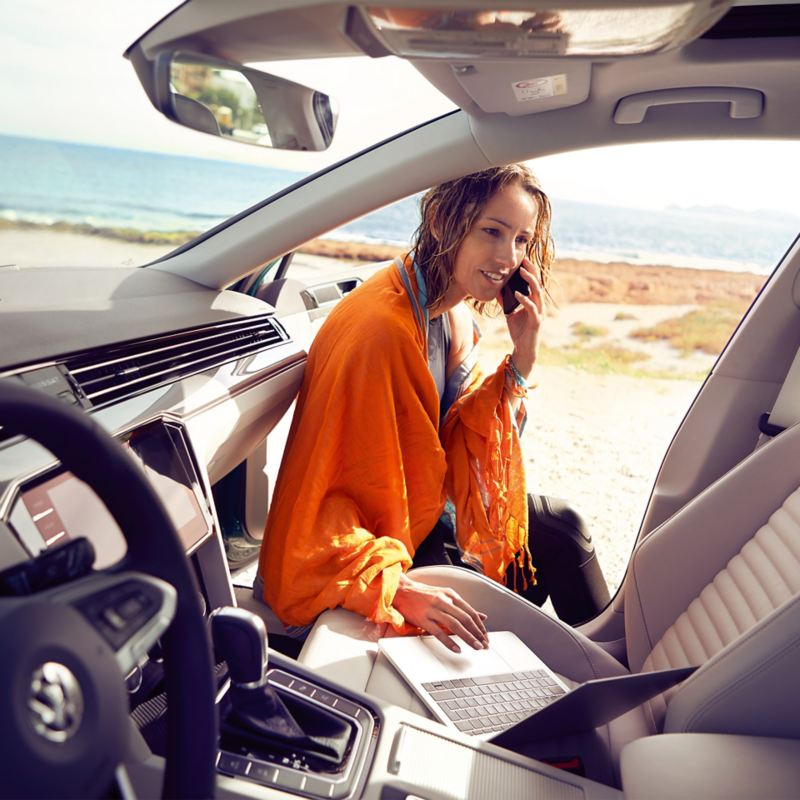 Lady using the wi-fi hotspot in her car