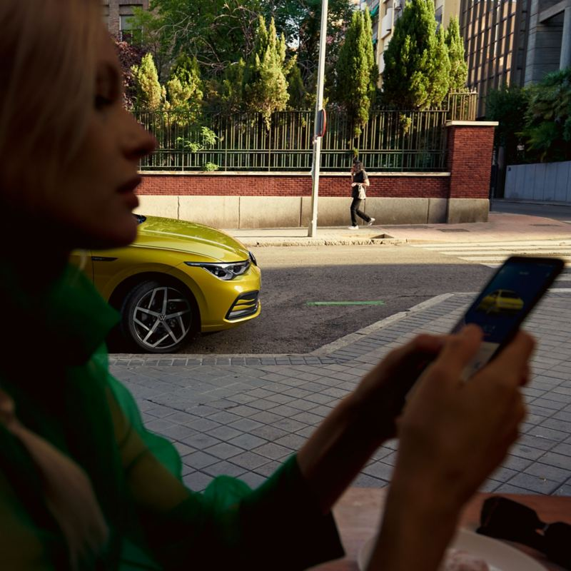 A lady checking her driving data on her smartphone