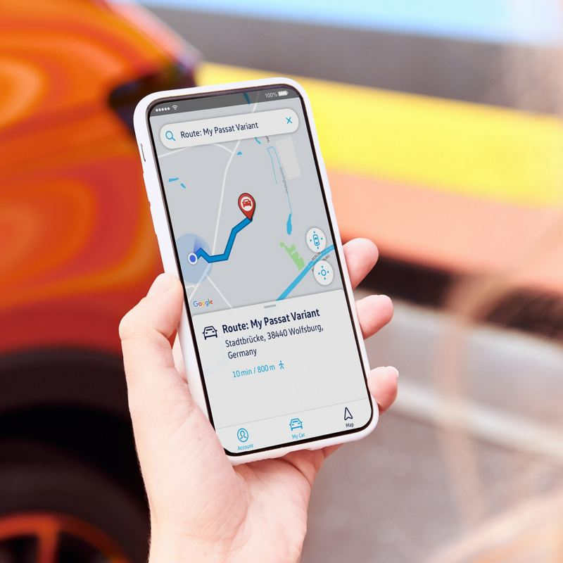 A person holding  phone, checking parking position on the We Connect app