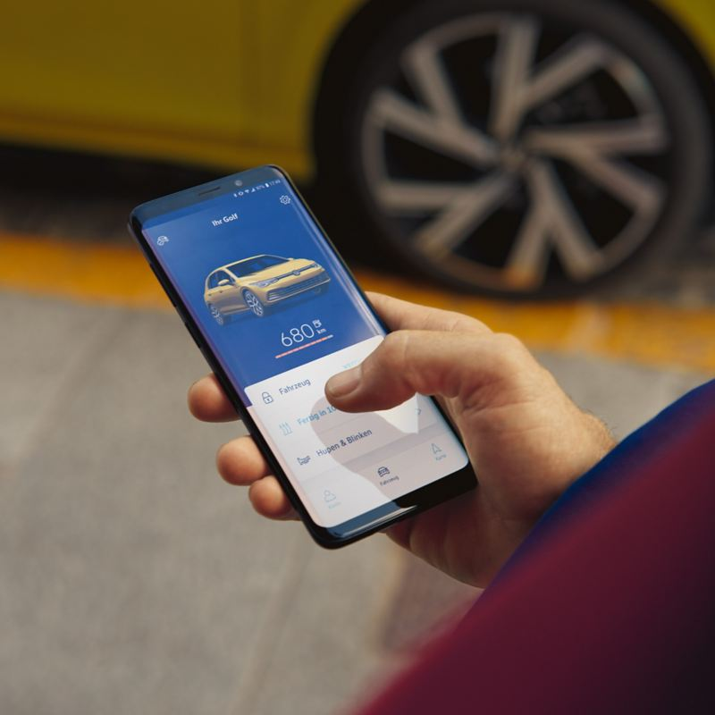 A person checking their vehicle status on the app